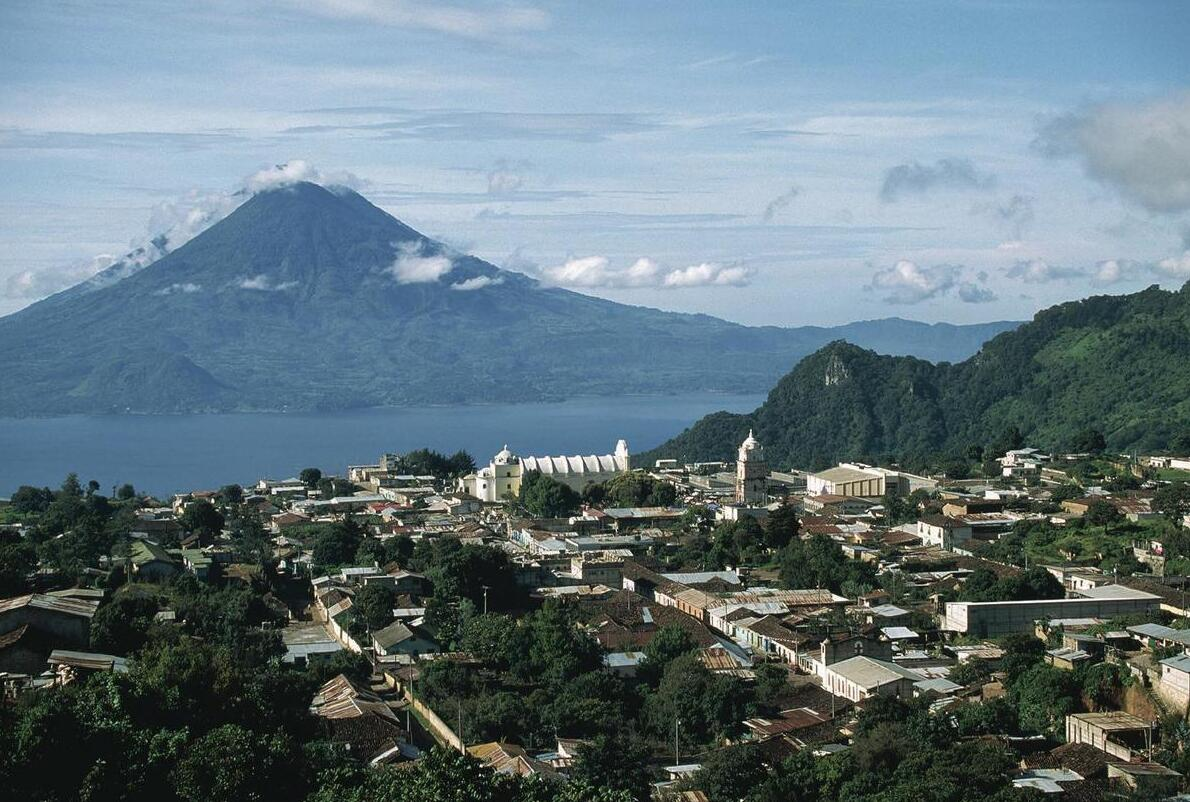 The city of Solola and Lake Atitlán in the foreground and the volcano San Pedro in the background.
